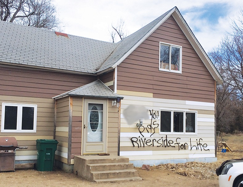 The home of missing Woonsocket woman Rachel Cyriacks was vandalized Sunday night with spraypainting on the front and a broken window.