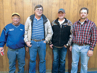 Pictured are: Chuck Peer, third, Leo Effling, second, Patrick Bender, champion, and Steve Nelson, high hand.