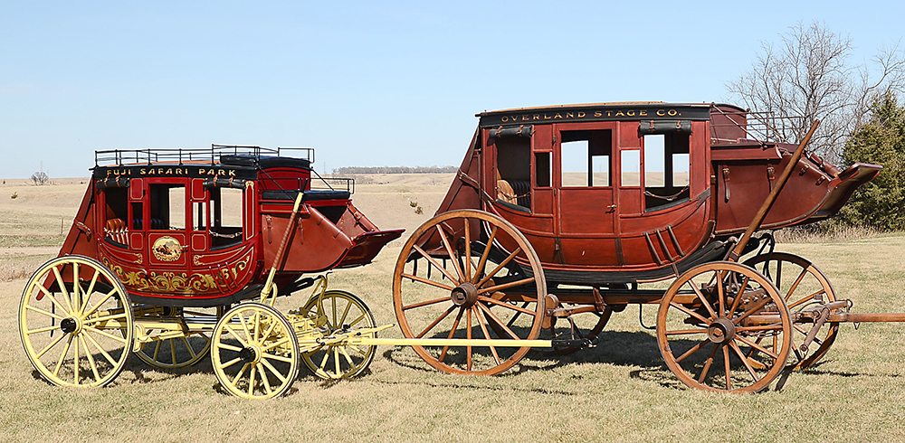 This three-quarter scale Concord stagecoach built by Hansen Wheel & Wagon Shop for Fuji Safari Park in Japan is pictured alongside one of their full-size stagecoaches. The stagecoach was to leave the wagon shop near Letcher  on Wednesday for a 30-day journey to Japan.