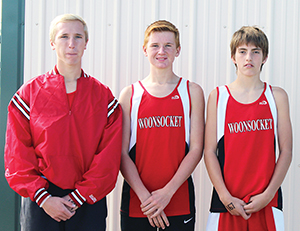 LEFT TO right, Rex Schlicht, Spens Schlicht and Malachi Bruce make up the three-man Woonsocket Cross Country team.
