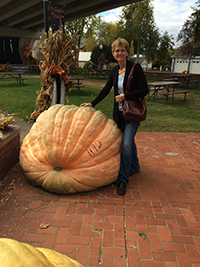 GAY POSES with her favorite pumpkin.