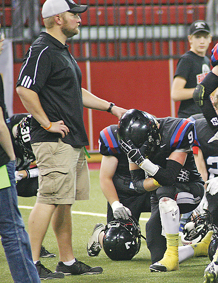 COACH COREY Flatten provides a little comfort to quarterback Tucker Kingsbury and the rest of his players as the reality of the loss sinks in.