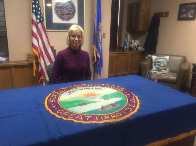 SECRETARY OF STATE Shantel Krebs with returned original flag