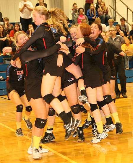 """NEAR HYSTERICS, the girls celebrate their State """"B"""" berth after scoring the winning point."""
