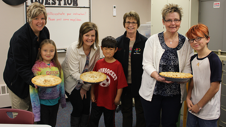 Woonsocket Elementary teachers Sarah Jensen, Kylie Pauly, Judy Hinker and Rosemarie Delvaux kicked off American Education Week with a delivery of apple pies made by the Town 'N Kountry Kids 4-H Club from club members Dani Brooks, Elisha Schultz and Braxton Gentles.