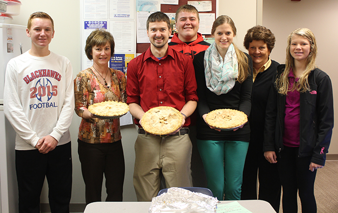 The Town 'N Kountry Kids 4-H Club made and delivered apple pies to the teachers at Woonsocket School to celebrate American Education Week.  Pictured are Spens Schlicht, Lynn Klaas, Mitch Korbel, Riley Schmiedt, Dayna Rodriguez, Cathy Hegg and Megan Linke.