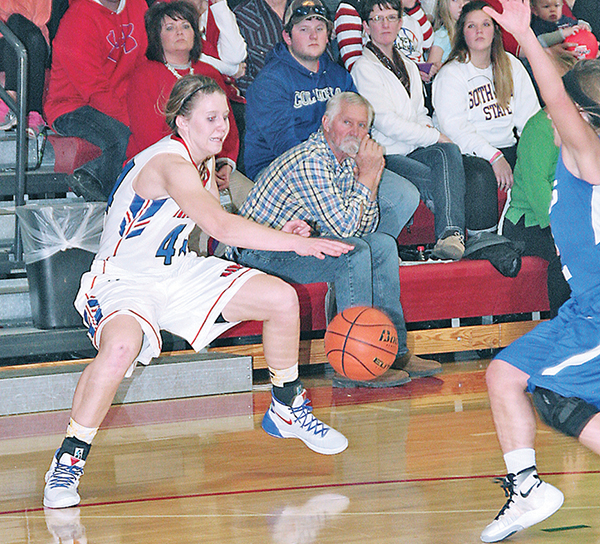 MYAH SELLAND masterfully gets a loose ball under control then proceeds to take it to the basket for another two points during second half action Monday night.
