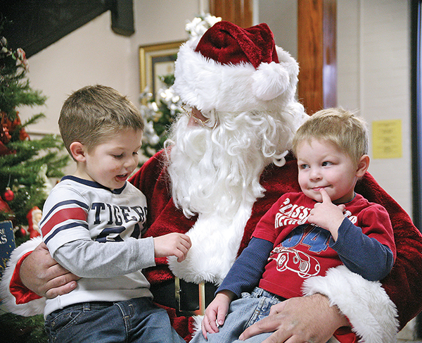 Above, Carson and Ridley Miller, sons of Bud and Casey Miller, let Santa know what's on their Christmas lists.
