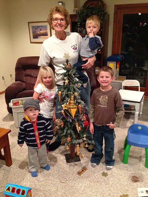 The Grandkids decorate a tree for Grandma Gay