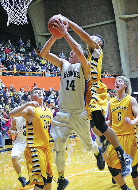 DILLON MOORE battles through a Wolsey-Wessington defender for two of his 12 first quarter points.