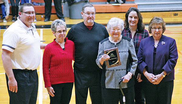 "Superintendent of Woonsocket School Rod Weber presented Ace's mother and family with a plaque inducting Greg ""Ace"" Uken into the 281 Conference Hall of Fame Thursday night during the championship games. Pictured from left to right are Rod Weber, sister-in-law Beth Uken, brother Glen Uken, mother Mardella Uken, sister Gina Trebilcock and sister Gloria Damgaard."