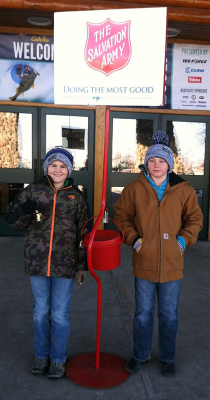 Kade Olinger and Camden Jost are enjoying the brisk Saturday morning accepting donations for the Salvation Army outside of Cabela's in Mitchell.