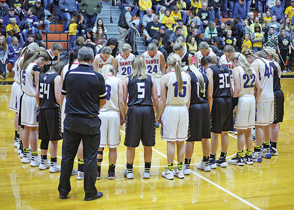 "AT THE conclusion of the Girls' 281 Championship game, players from both teams, the James Valley Christian Lady Vikings and the Sanborn Central/Woonsocket Lady Blackhawks, gathered in a circle to say a prayer for one of SCW's head coaches, Rob Baruth.  After 10 years cancer free, Baruth recently found out his melanoma had returned. He was unable to attend the tournament, as he had surgery the day before at the Mayo Clinic in Rochester.	 	Baruth is now home recovering from surgery and awaiting further treatment. 	Baruth's team and Blackhawk fans have taken up the motto, ""Same Team Different Fight,"" in reference to Tanna Kingsbury's battle with a rare form of adolescent bone cancer. One month before her 16th birthday, early in the fall of 2014, Kingsbury succumbed to her cancer, 18 months after her initial diagnosis."