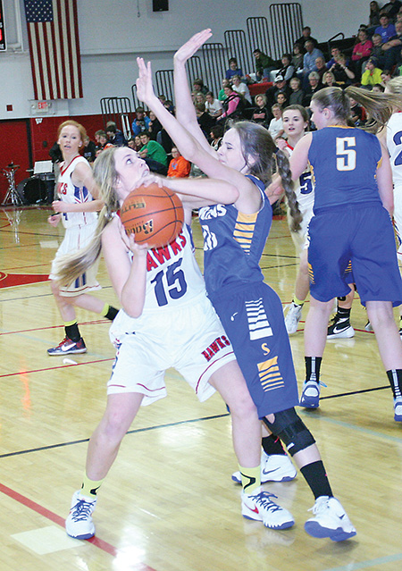 SANBORN CENTAL sophomore Sarah Morgan looks towards the basket through a Spartan defender during second quarter action last Thursday night.