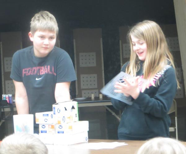 Noah and Kara Wormstadt giving their demonstration on Light Bulb Coloring.