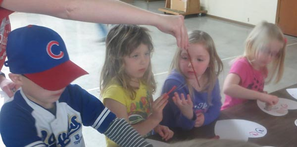 Clover Bud members paint hearts to give to others.
