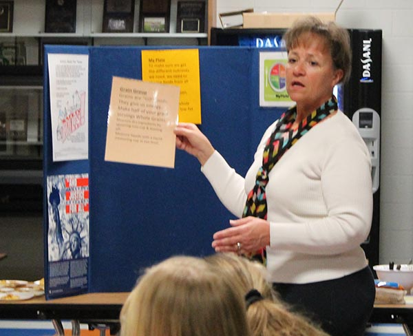 DIANE BECHEN instructs students on cooking healthy meals.