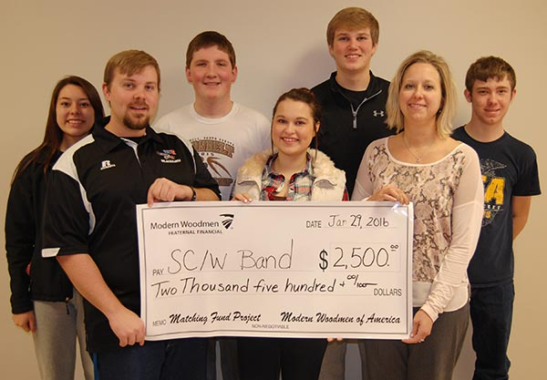SC/W Band Director Brett Kroeger and students receive $2,500 in matching funds from Modern Woodmen of America representative Stacey Malde.  Pictured are Kyla Morgan, Brett Kroeger, Shay Swenson, McKenzy Peterson, Shaun Snedeker, Stacey Malde and Aaron Linke.
