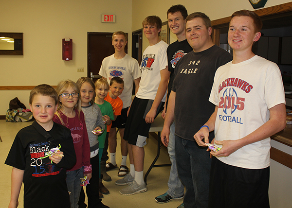 Cloverbuds Eli White, Trinity Kotilinek, Dani Brooks, Cassie Goettsch and Sutton Senska present a butterfly they made to Senior members Rex Schlicht, Shaun Snedeker, Wyatt Feistner, Riley Schmiedt and Spens Schlicht.