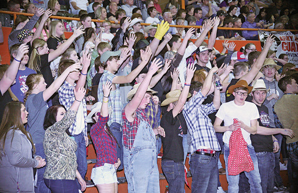 THE SANBORN Central/Woonsocket student body, dressed in that evening's theme, prepares for a free throw during the Friday night game.