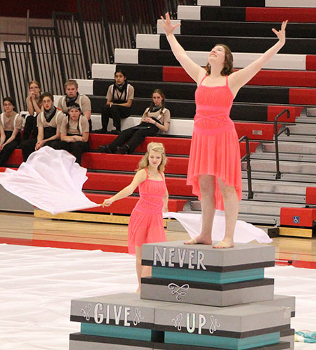 Renee Farmer presents her solo dance while Megan Linke performs with swing flags during the competition at the River Valley show.