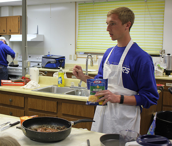 Rex Schlicht led a Special Foods workshop for 4-H members in Sanborn County.  Here he explains the preparation process of his tortilla bake casserole recipe.