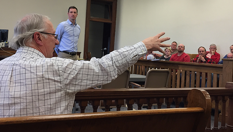 COREY JUHL and the Sanborn County Commissioners and Zoning Board listen as founder of Juhl Energy, Dan Juhl speaks.