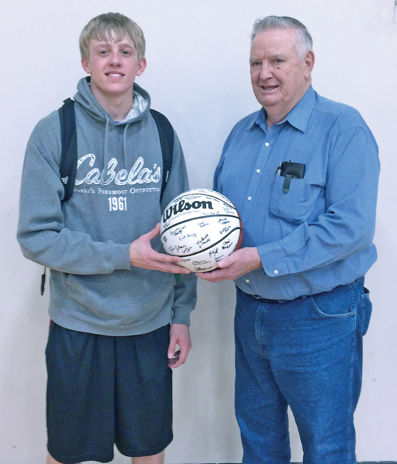 Dillon Moore and his grandfather, Howard Moore, after the area High School All- Star games held in Tea, SD on Sunday, April 3.