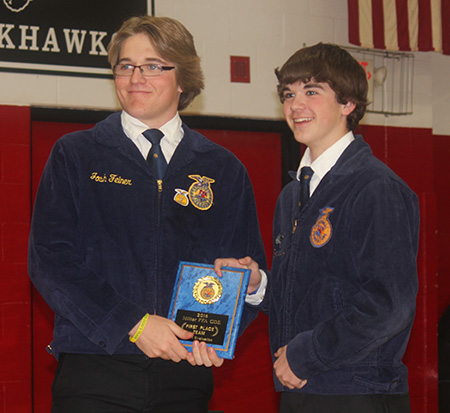 SC/W FFA Chapter Vice President Garrett Dean presents Trent Kingsbury with the Miller CDE Meats First Place Team plaque.  Trent led his team with a first place finish individually at the Miller event.