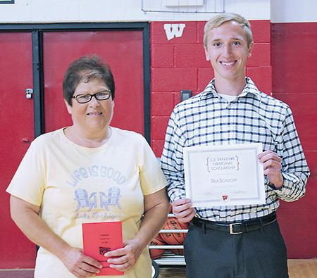 Pictured is Linda Burnison Kilcoin congratulating Rex Schlicht on winning the L.J. Van Dyke Scholarship.