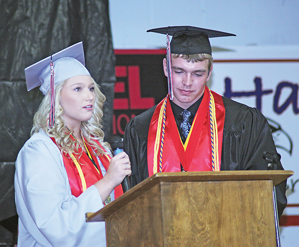 CO-SALUTATORIANS Tayla Weber and Garrett Larson together addressed the packed auditorium during Friday night's ceremony.