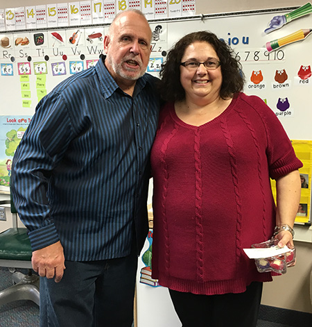CARRIE GUTIERREZ, fourth grade teacher at Woonsocket Elementary, received a $1,000 scholarship last week from SD Retired School Personnel scholarship chairman Bill Zubke.