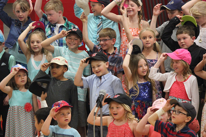 "Woonsocket Elementary students don baseball hats for their rendition of ""Take Me Out to the Ballgame"" during the annual spring concert Tuesday evening, May 3."