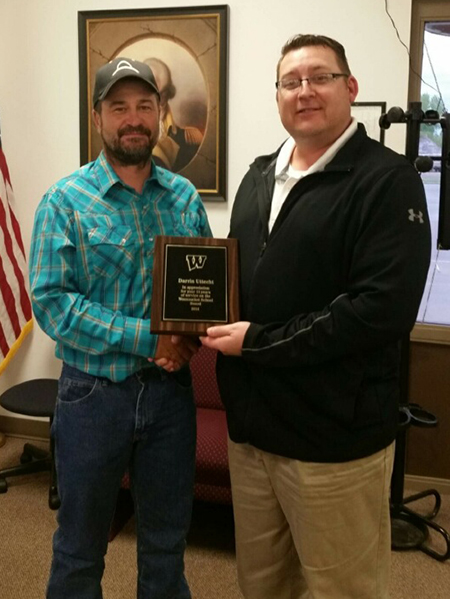 SUPT. WEBER presents Darrin Uttecht with a plaque of appreciation for his service.