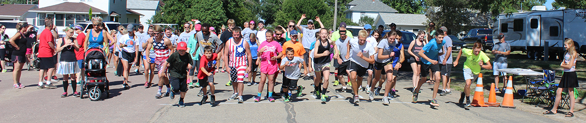 5K PARTICIPANTS take off from the starting line during Saturday morning's race.