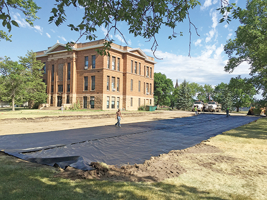 VISITORS TO the Sanborn County Courthouse won't have to worry about finding a parking spot soon, as the parking lot is being expanded nearly all the way to the road on the south side of the block.