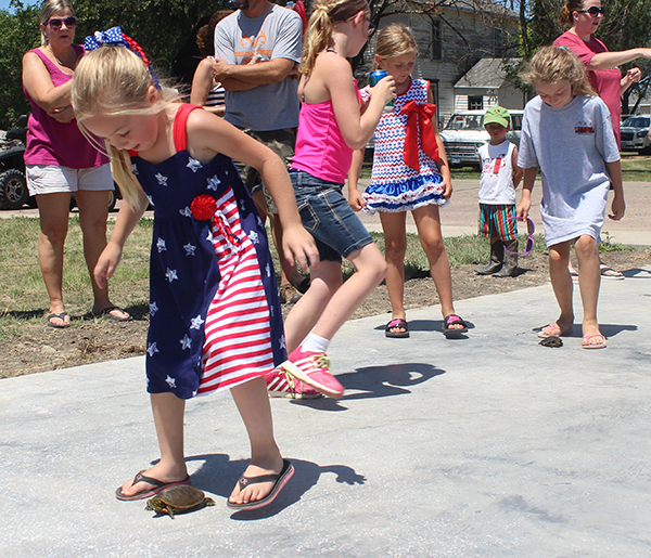 WAVERLY HAGMAN took home first place honors in her age 6-9 division in the Water Festival Turtle Races.