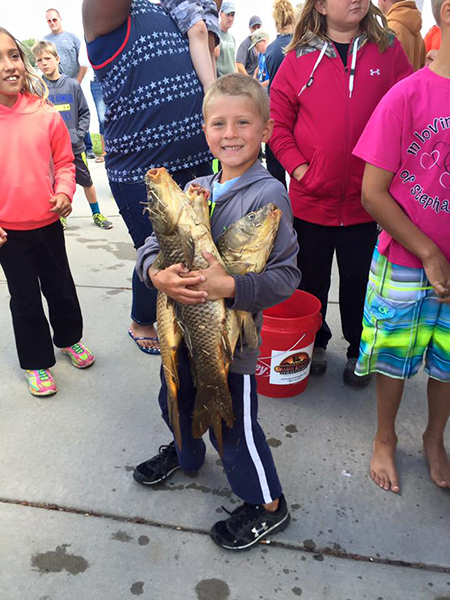 DAYTON EAGLE shows off his loot following the Water Festival fishing derby held Sunday morning.