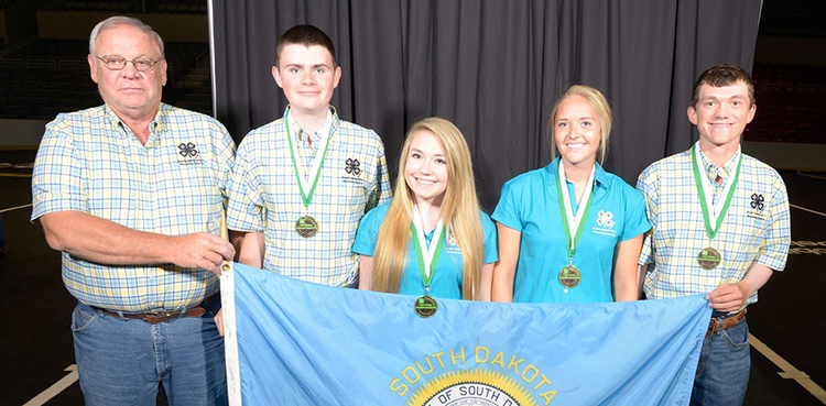 The Air Pistol team is pictured with their third place medals from the silhouette competition:  Coach Art Kneen, Jesse Mills, Gracie Wold, Krista Dvorak and Seth Shorb.