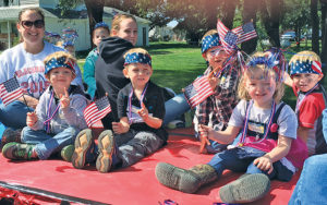 THE PRESCHOOL class showed their American and Blackhawk pride with their very first homecoming float.