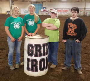 The Town 'N Kountry Kids Red Crew 4-H Club set barrels for the Grid Iron Futurity Maturity event this past week in Huron.  Pictured are club members Morgan Schmiedt, Megan Linke, and Henry and Charles Hunter.  Also setting barrels this weekend were Aaron and Nathan Linke and Bailey Feistner.
