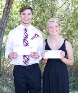 TOM HETLAND and Bailey Moody with their scholarship checks, made possibly by Hegg Insrance and Farm Mutual Insurance.