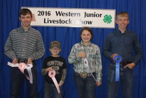 Sanborn County 4-Hers Aaron Linke, Cannon Zoss, Delaney Zoss and Nathan Linke show off their ribbons.