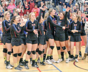 THE BLACKHAWK girls celebrate their second straight Region 3B win and realize they just earned another trip to the State B Volleyball Tournament. The Hawks are seeded last in the tournament, so will face a tough challenge in their first match, as they meet No. 1 seeded Northwestern, Thursday at noon.
