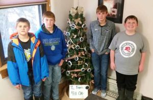 TL Rangers 4-H Club members who helped to put up their tree at the courthouse this year are, from left to right: Kade Olinger, Camden Jost, Clay Olinger, and Blake Howard.