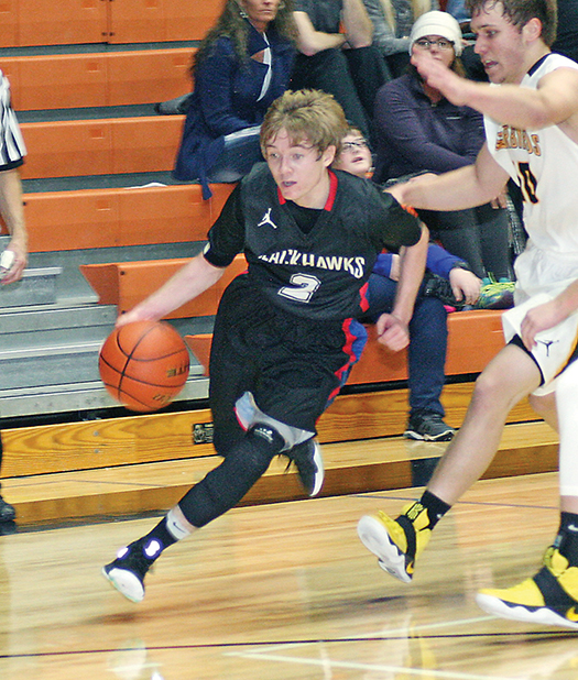 SENIOR TREVOR Olson drives to the basket during first-half action Thursday night in Huron.