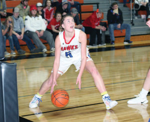 SOPHOMORE AND high point earner of the night, Megan Poyer, gets low before going up for two more Thursday in Huron. Poyer put up an impressive 25-point performance in the game.