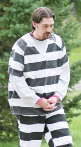 MATTHEW NOVAK being brought to the Sanborn County Courthouse last October.