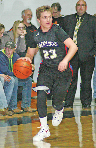 TRENT KINGSBURY brings the ball down court in a game earlier this season. With one regular season game to go, Kingsbury broke the Blackhawk single season assist record formerly held by his older brother.