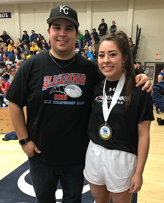 Woonsocket School Powerlifter Kyla Morgan placed first in the Class A division and third overall in the state Powerlifting Championship held at O'Gorman High School last weekend. She is pictured with her coach Armando Rodriguez.